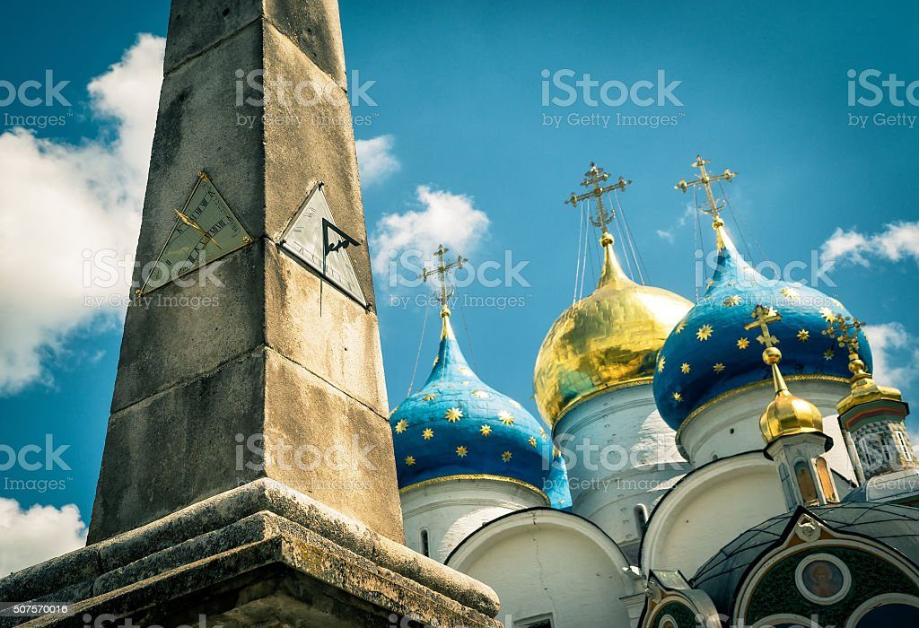 Old sundial on background of Assumption Cathedral in Trinity Ser stock photo