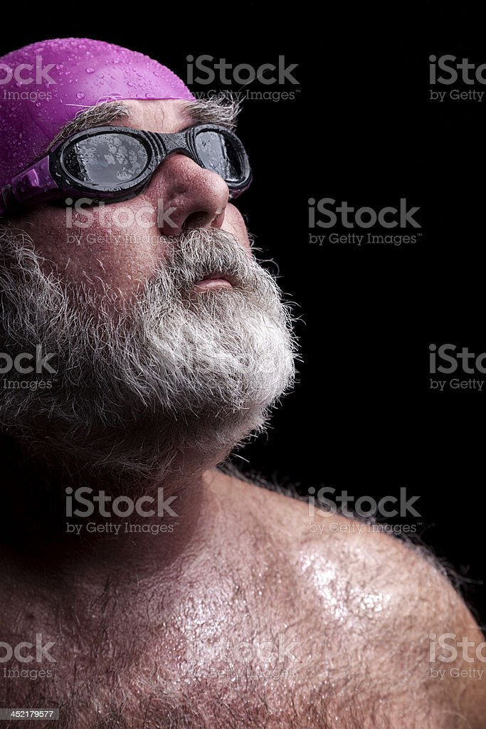 Old Swimmer In Cap And Goggles stock photo