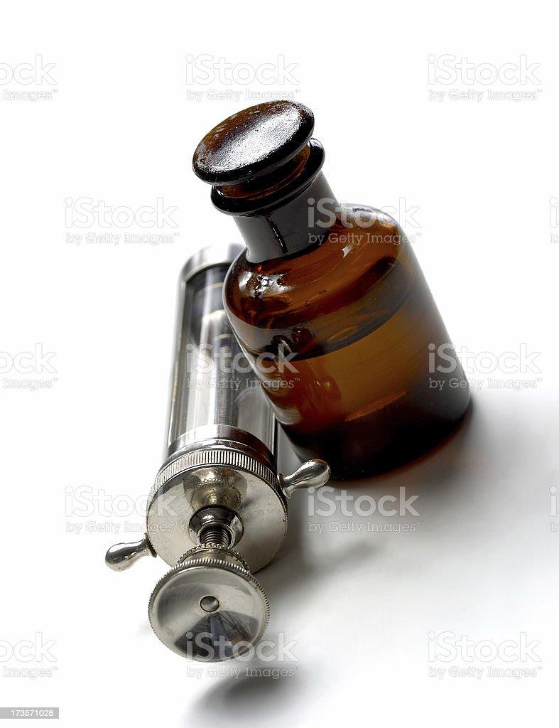 Old Syringe & Medicine Bottle royalty-free stock photo