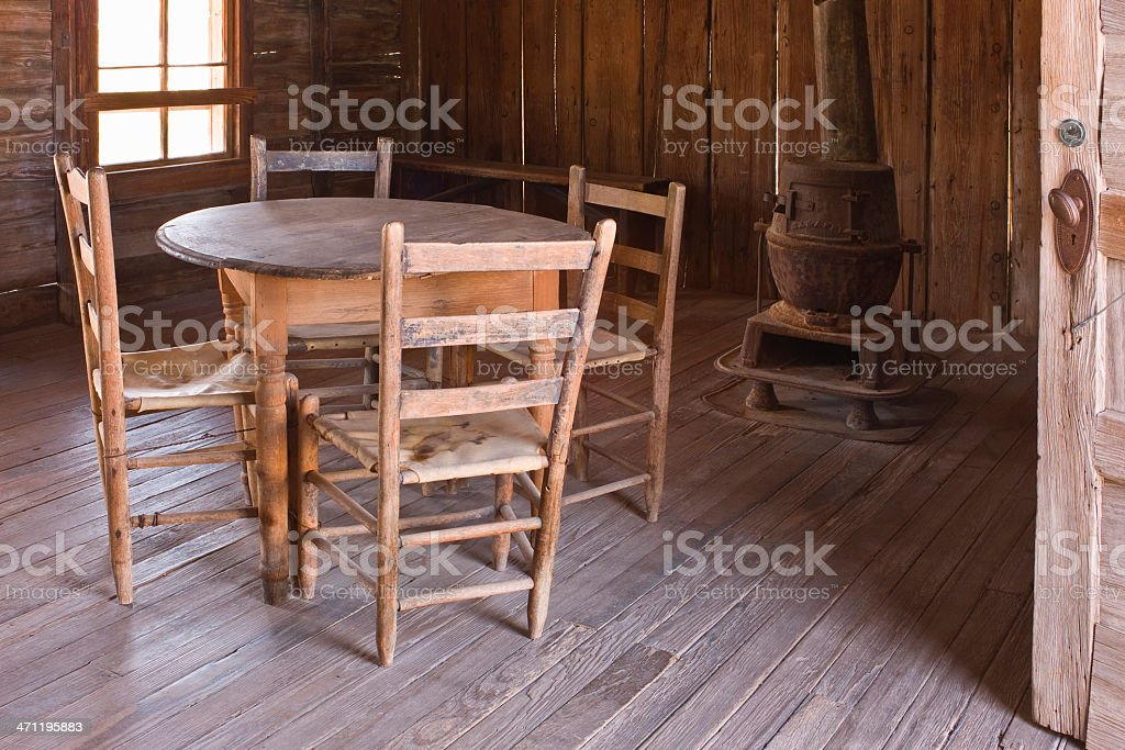 Old Table, Chairs, and stove at Judge Roy Beans Saloon. stock photo