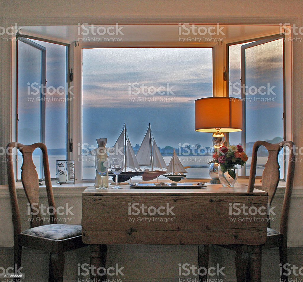 Old Table Chairs looking through Bay Window stock photo