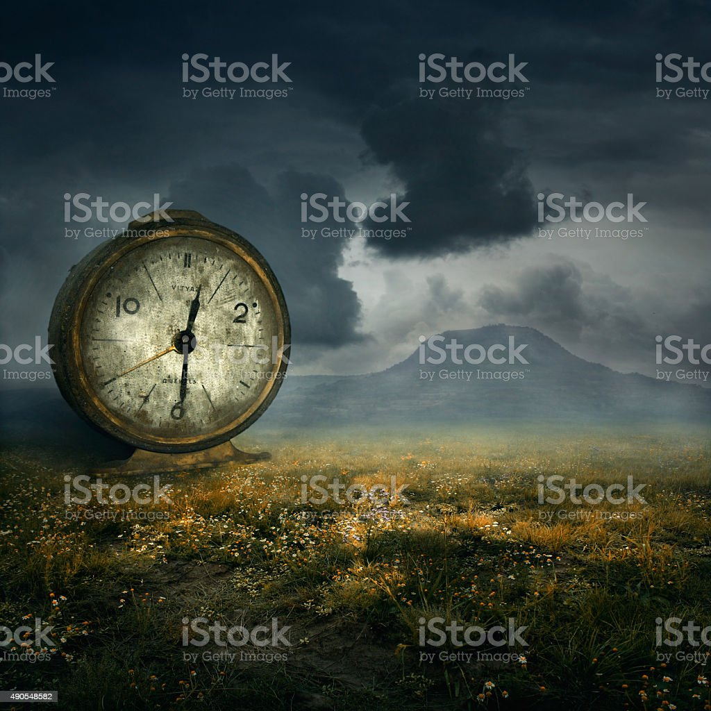 Old table clock in fantasy atmosphere stock photo