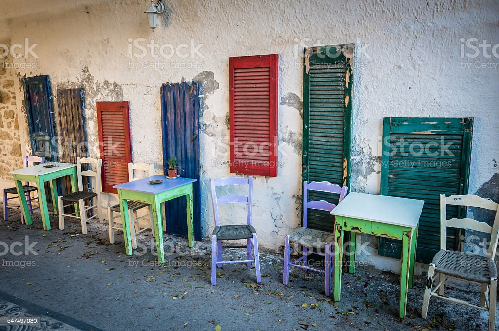 Old tables and seats on street. stock photo