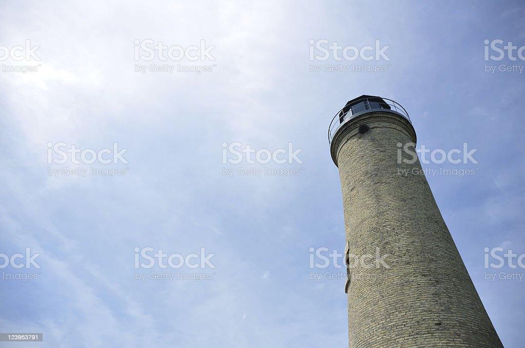 Old Tan Brick Lighthouse stock photo