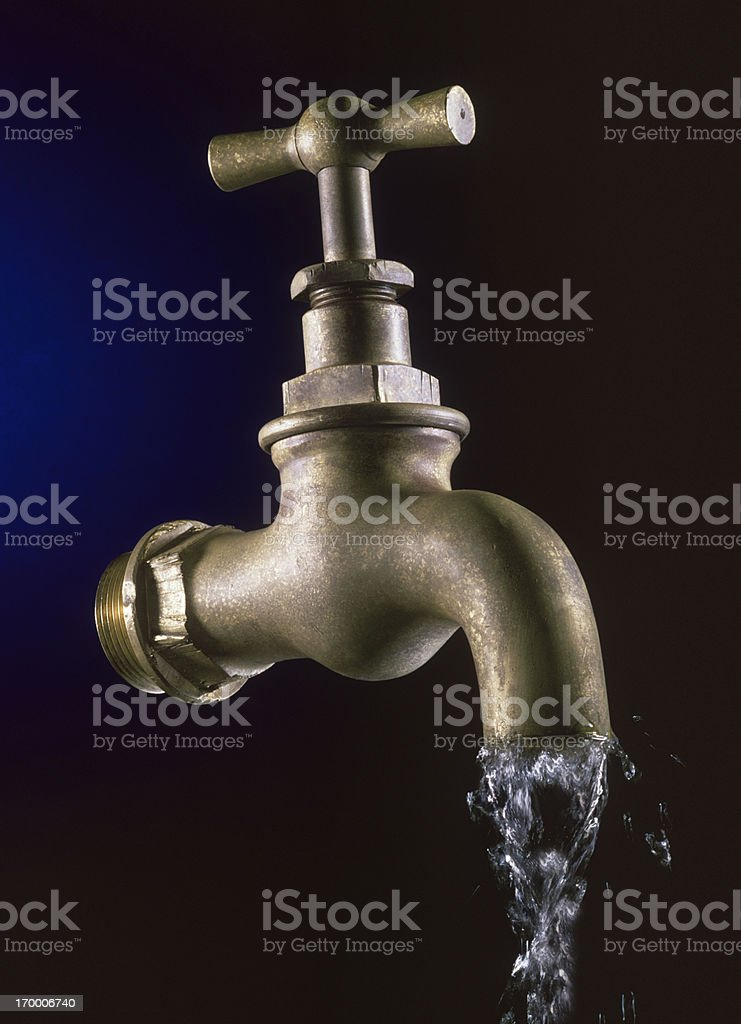 Old tap isolated with flowing water royalty-free stock photo