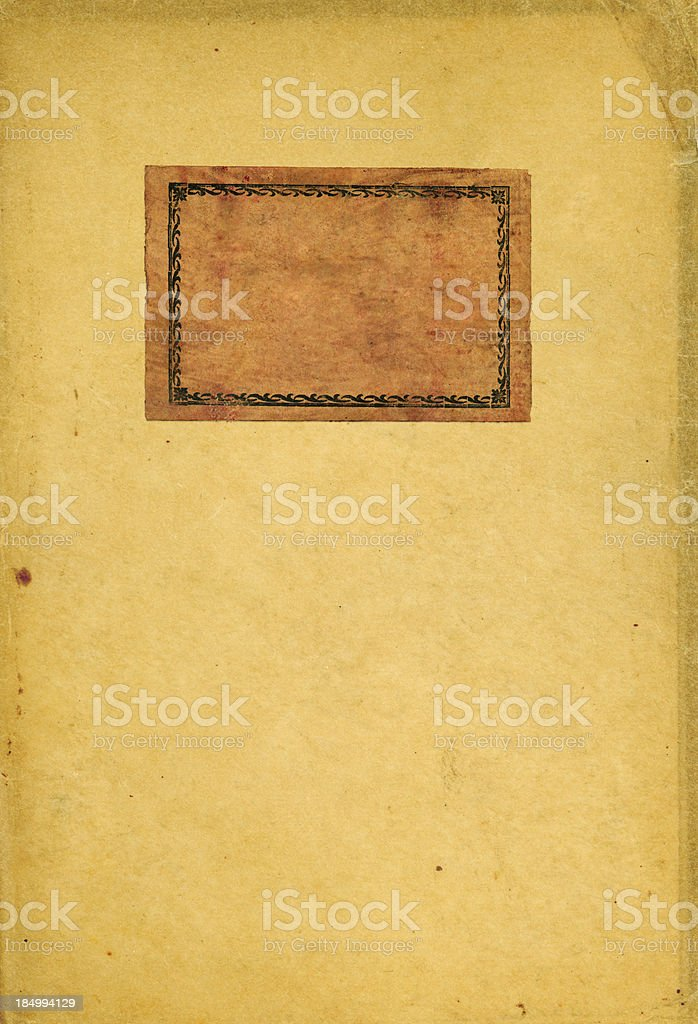 Old taped up rough edged paper with label at corner royalty-free stock photo