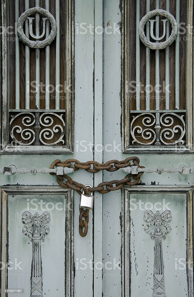 old tarnished brass doors with lock and chain royalty-free stock photo