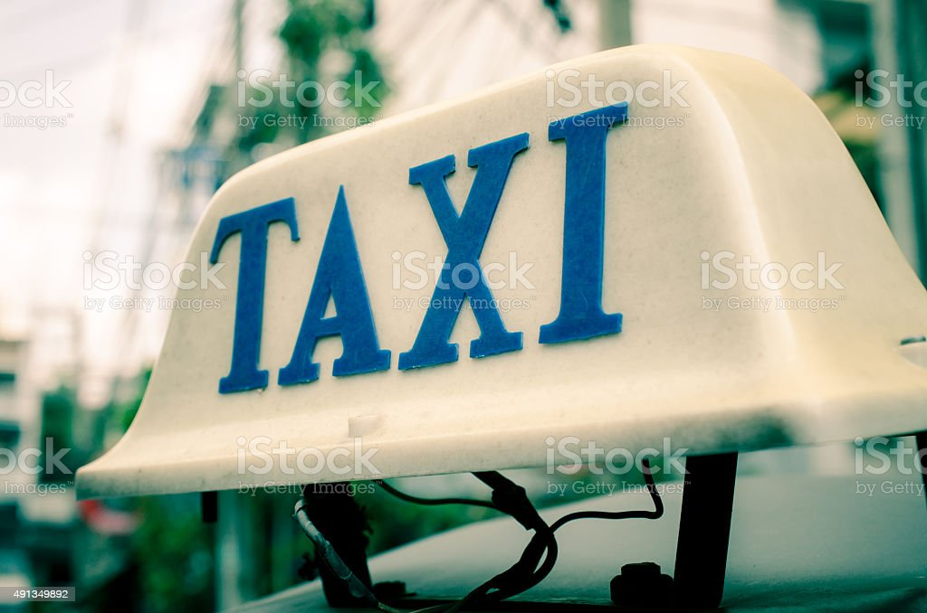 Old taxi sign on roof top car stock photo