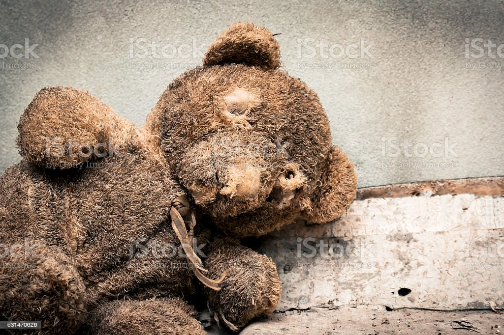 Old teddy bear abandoned piles of paper stock photo