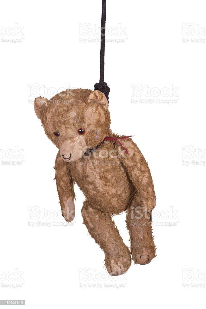 old teddy bear hanging on gibbet stock photo
