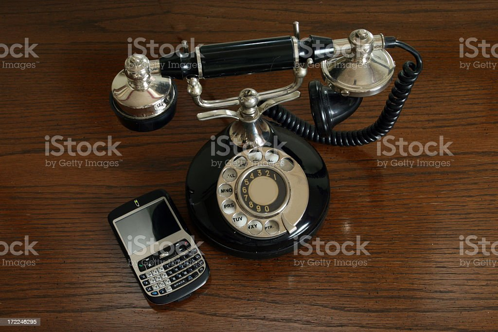 Old Telephone and New Mobile Phone on Wood Background royalty-free stock photo