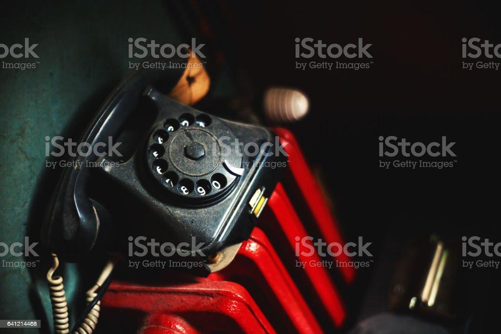 Old Telephone on Red Radiator stock photo