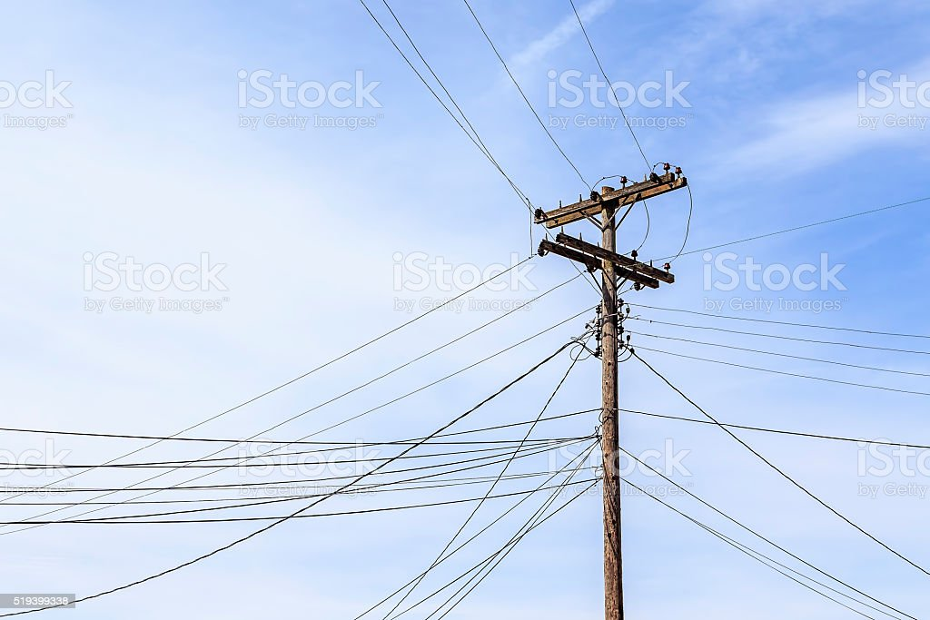 Old Telephone Pole with Many Lines stock photo