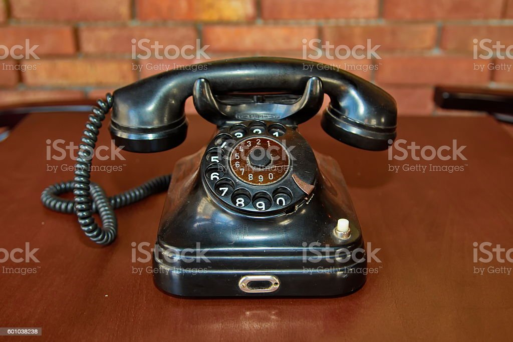 Old telephone with rotary dial stock photo