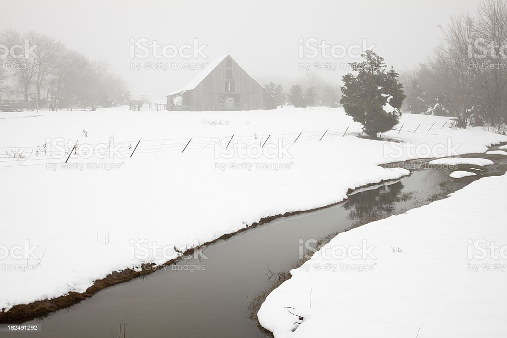 Old Texas Barn and Creek in Fog After Snowstorm royalty-free stock photo