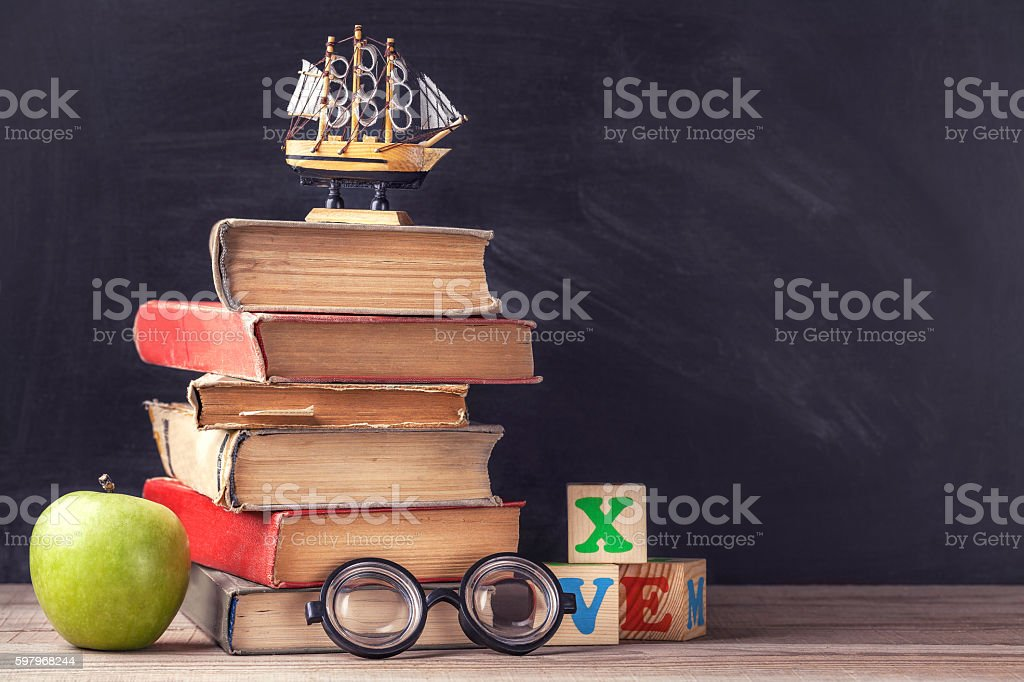 Old textbooks are on the rustic wooden table stock photo