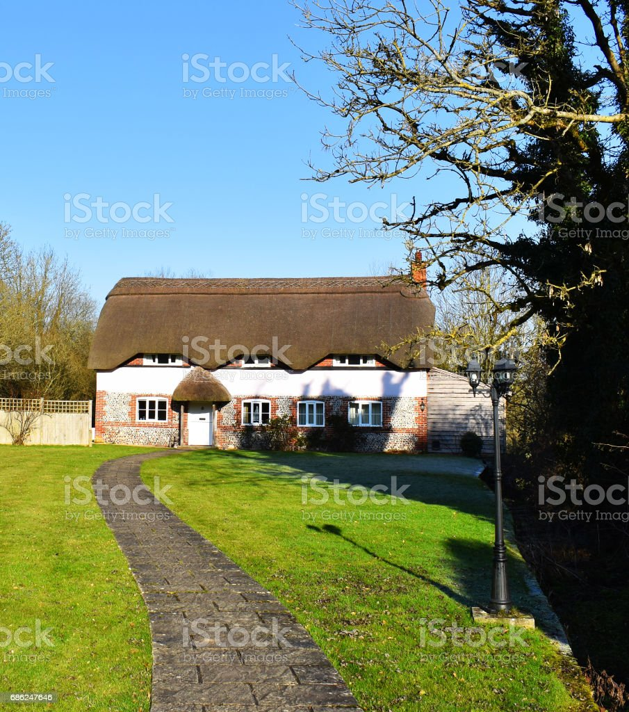 old thatched house stock photo