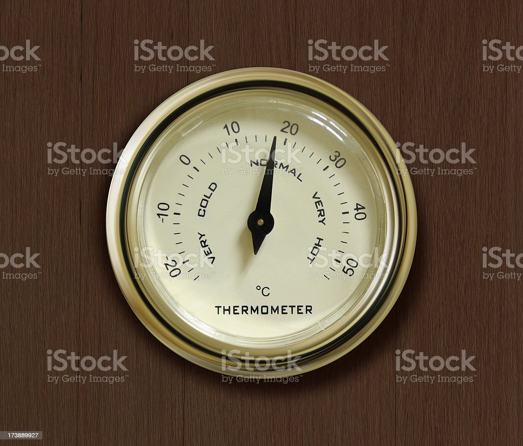 Old thermometer on wooden background. stock photo