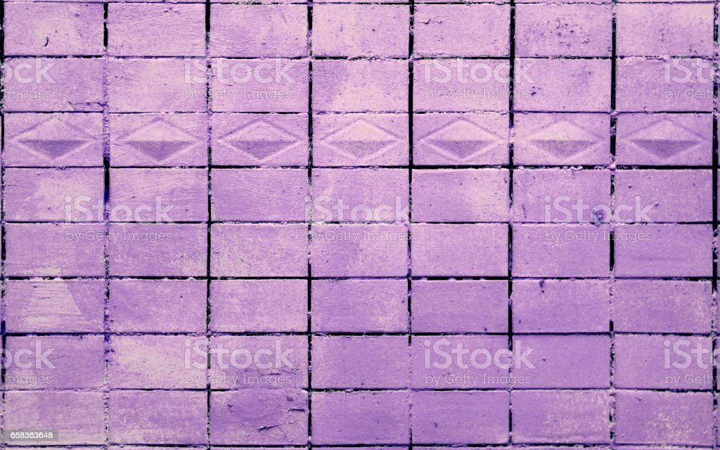 Old Tile Wall Texture Painted in Purple stock photo