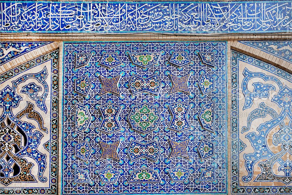 Old tiled design with traditional Persian patterns on wall stock photo