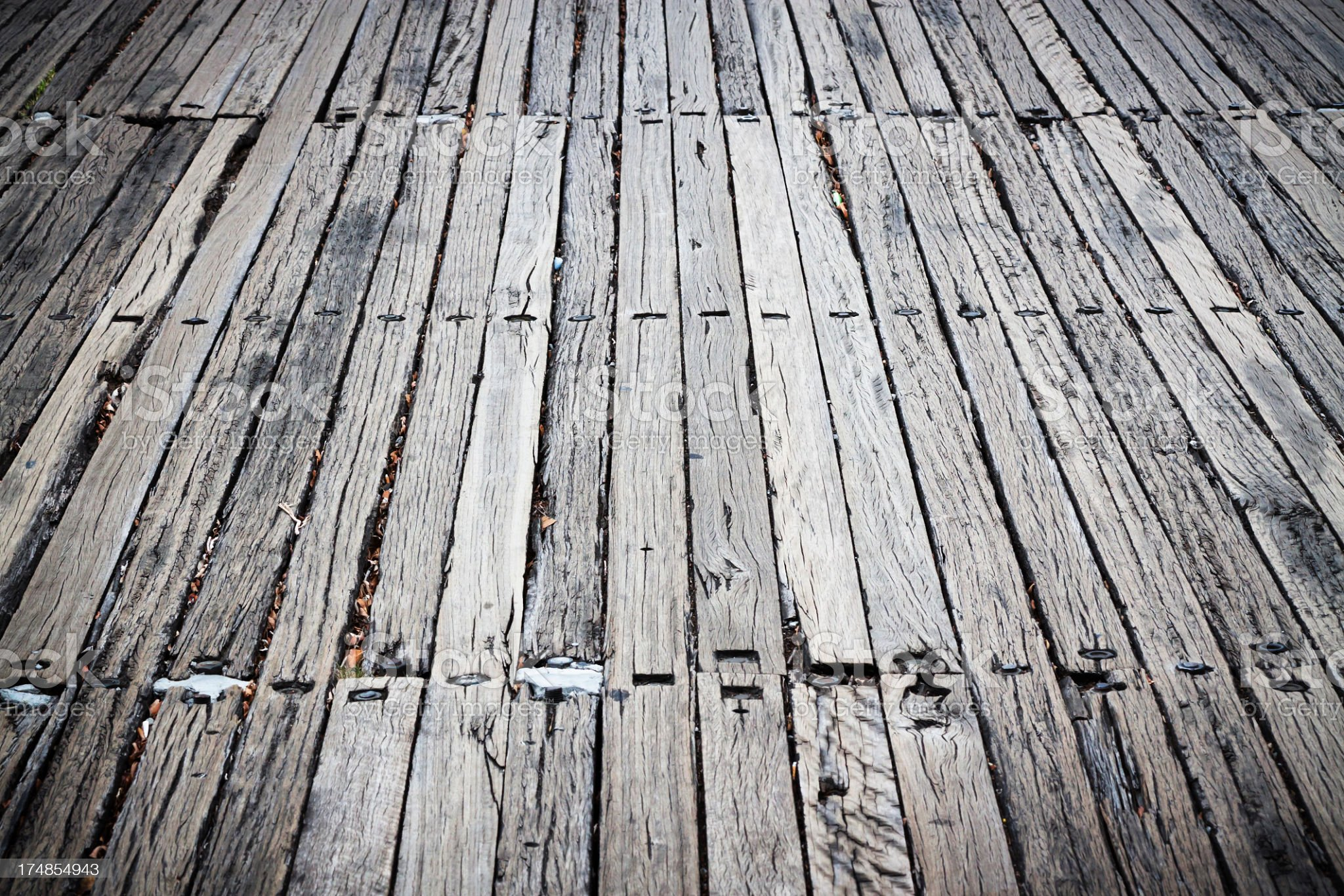 Old timber sleepers road with bolts, copy space and vignette royalty-free stock photo