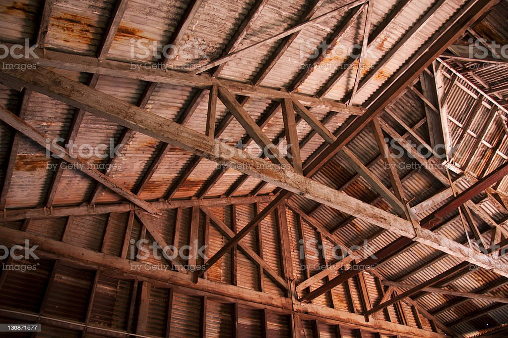 old timber trussed roof - internal stock photo