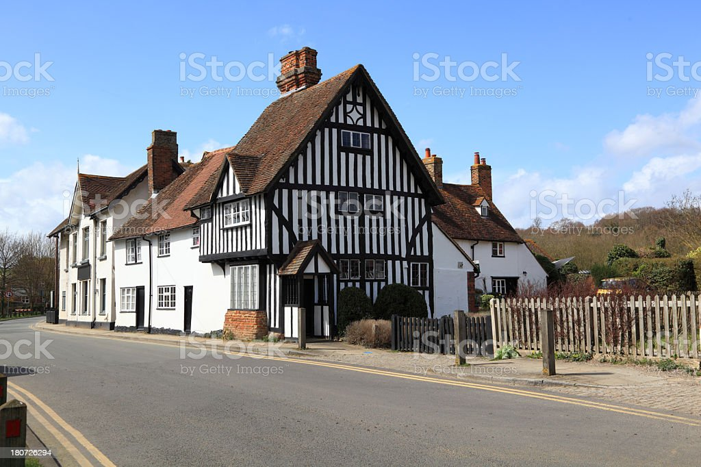 old timberframe house in english village stock photo