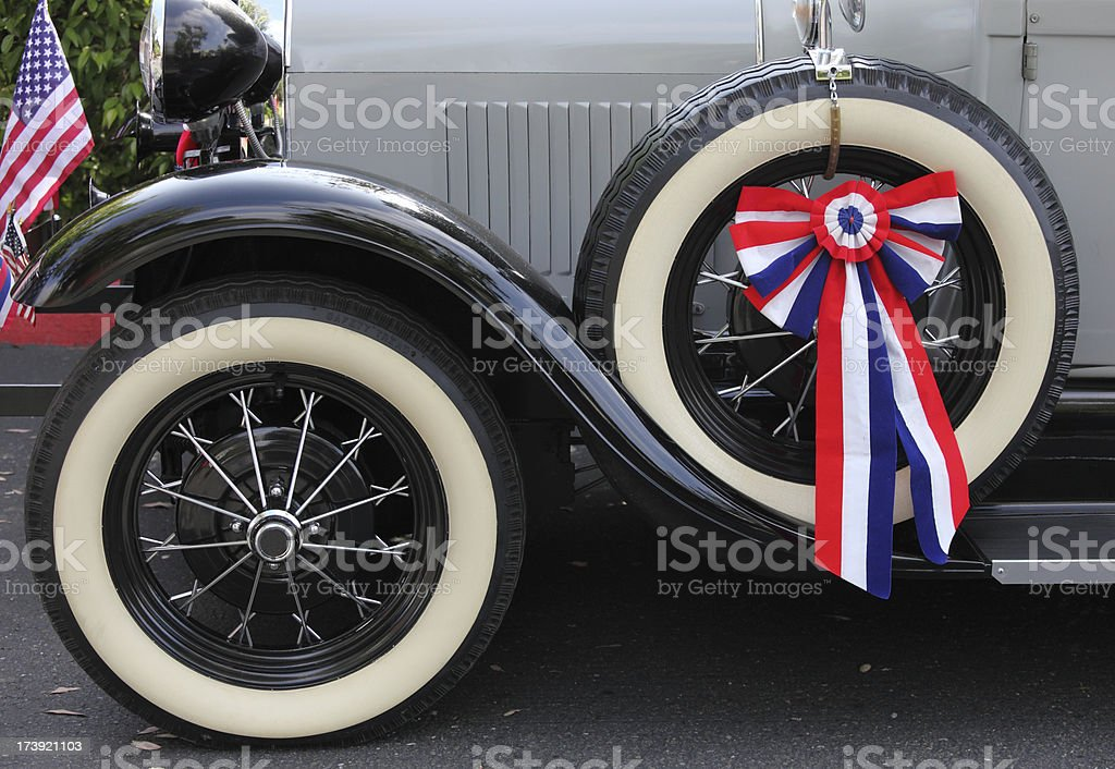 Old time motorcar on Fourth of July royalty-free stock photo