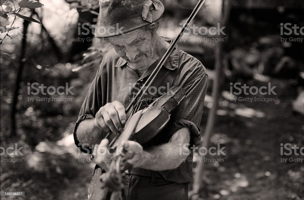 Old timer playing his fiddle (1980) stock photo