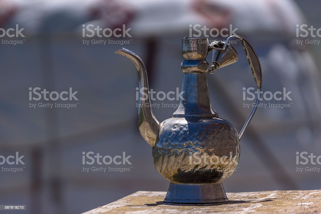 old tin kettle outside a yurt stock photo