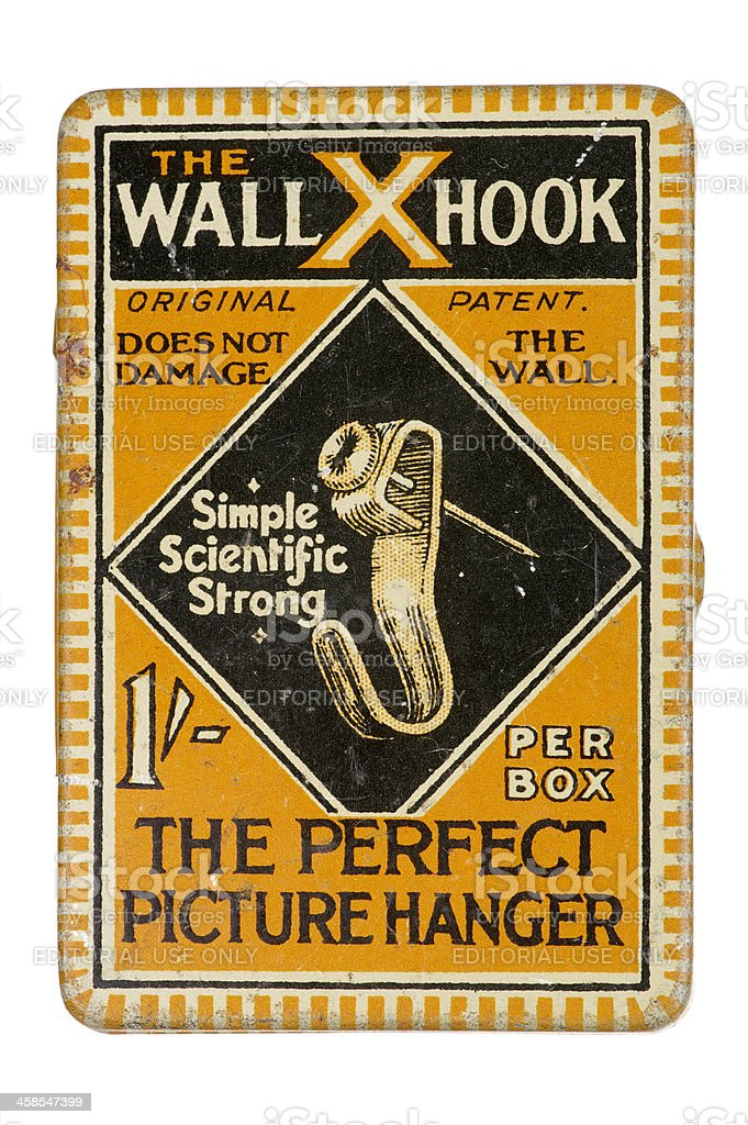 Old Tin Of Picture Hanging Hooks royalty-free stock photo