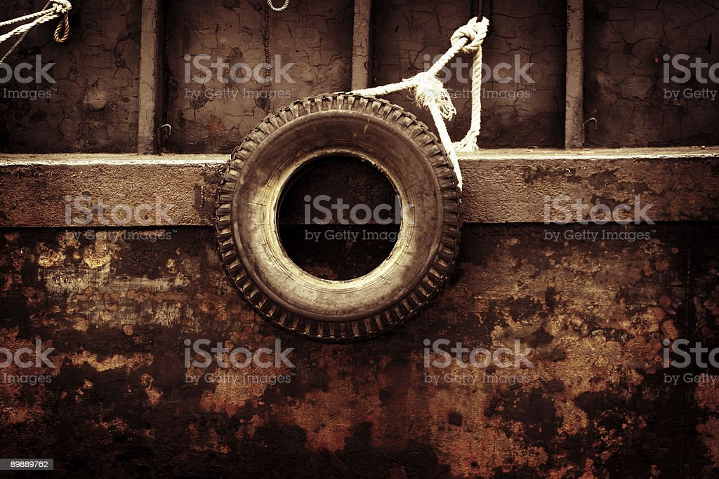 Old Tire on the Side of Ship royalty-free stock photo