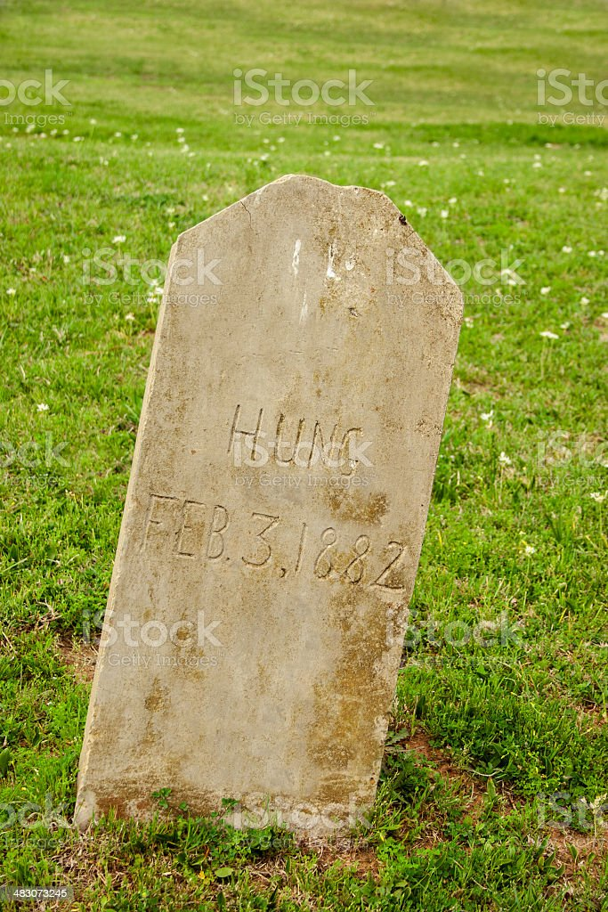 Old tombstone in cemetary.  Man was hung, 1882. stock photo