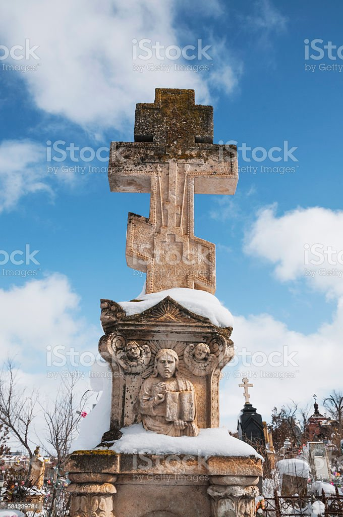 Old tombstone over the grave. stock photo