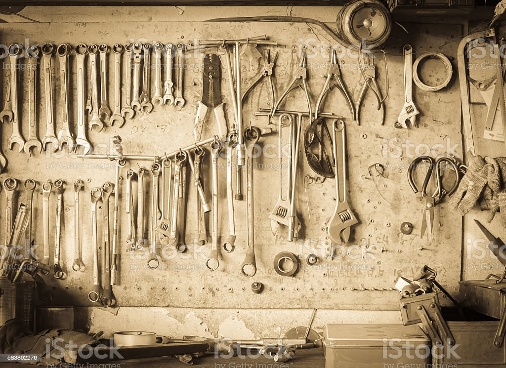 Old tool shelf against a wall vintage style stock photo