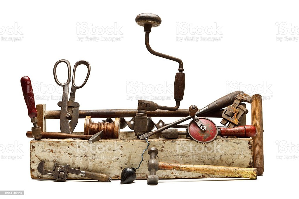 Old tools in a wooden toolbox isolated on white. stock photo