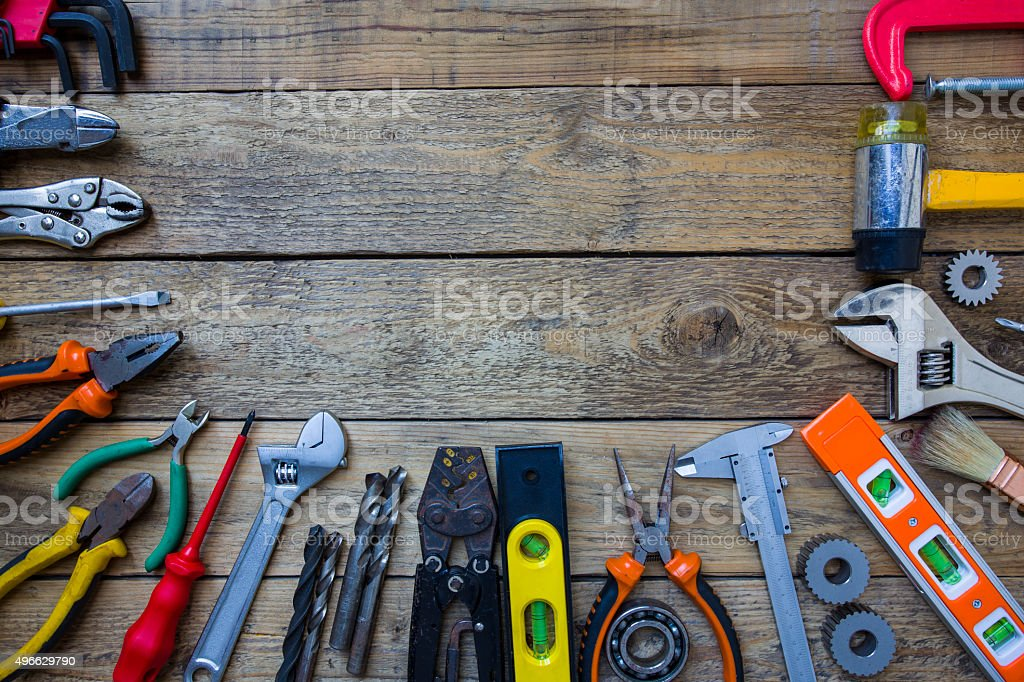 Old tools on a wooden table, industry tools concept stock photo