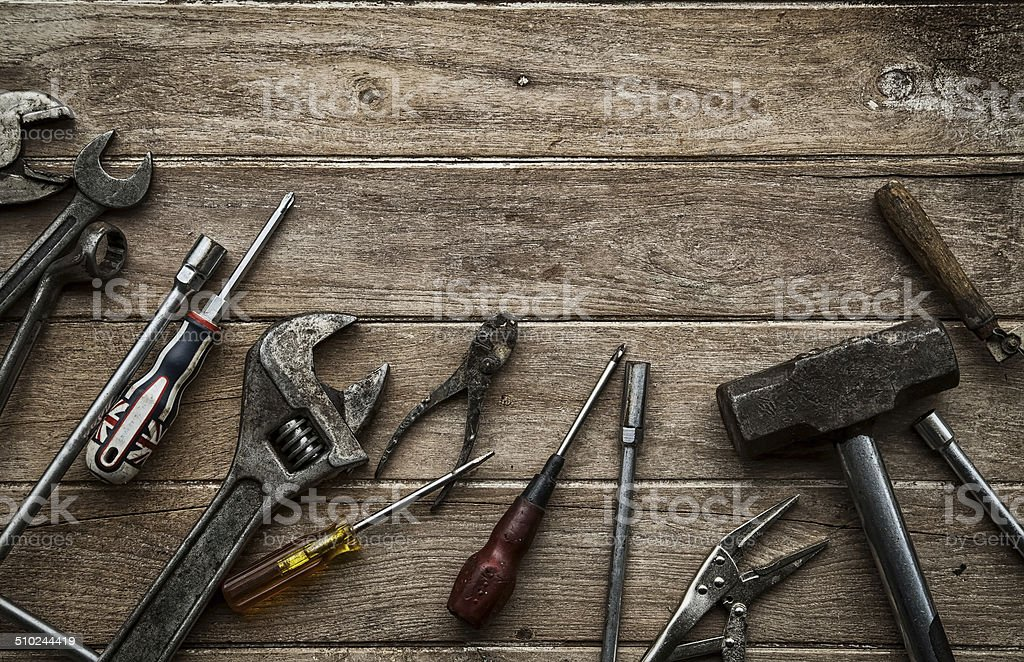 Old tools on a wooden table stock photo