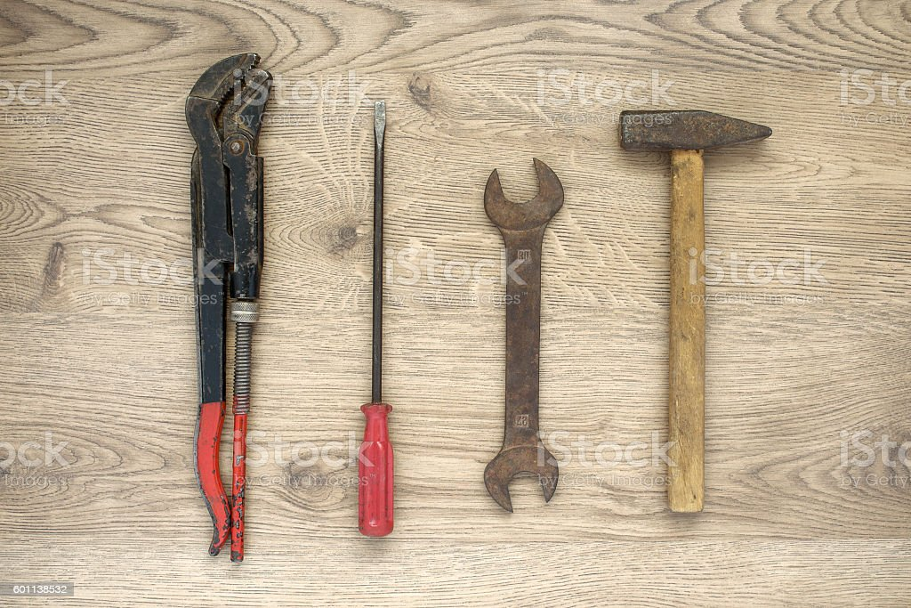 Old tools on wooden background stock photo