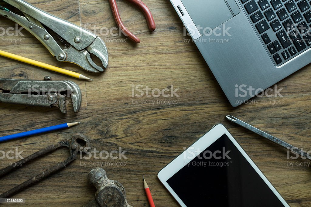 Old tools , tablet, computer on a wooden table stock photo