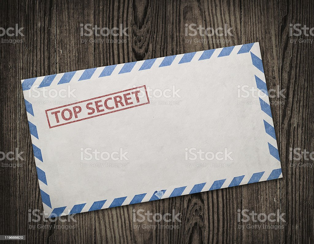 Old top secret envelope on table. stock photo