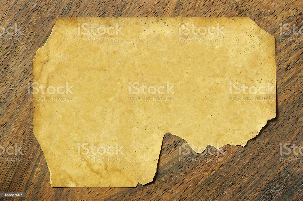 Old Torn Label On Wooden Background stock photo