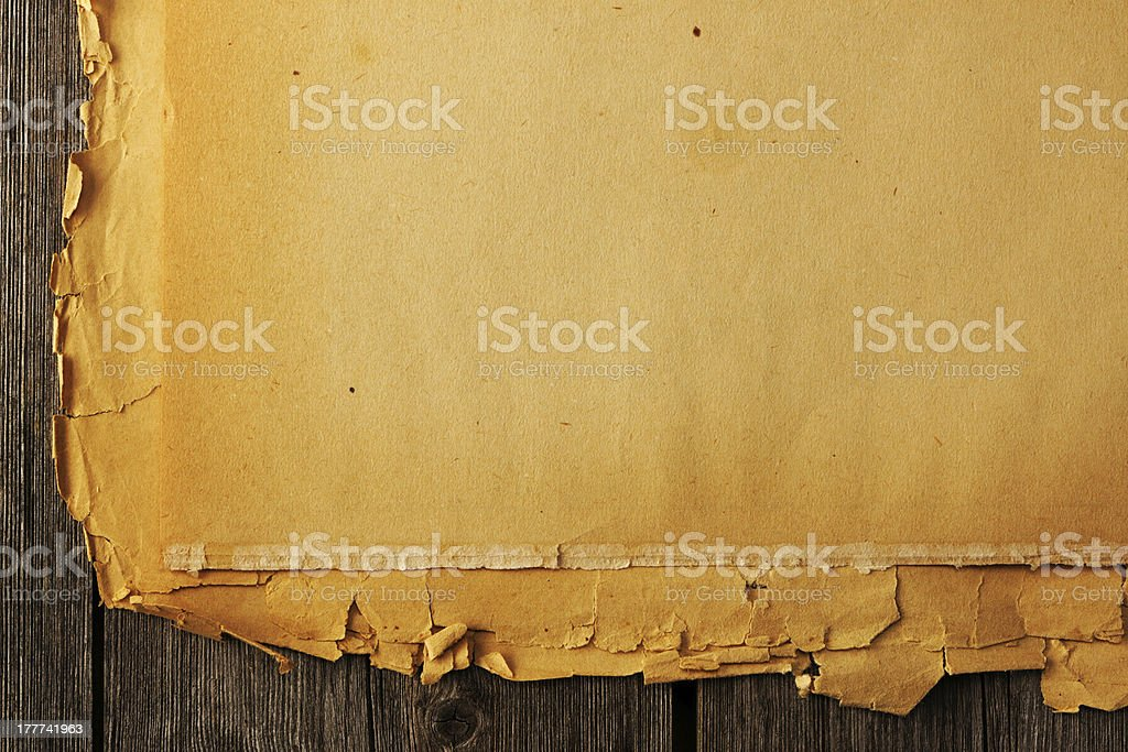 Old torn paper on the background royalty-free stock photo