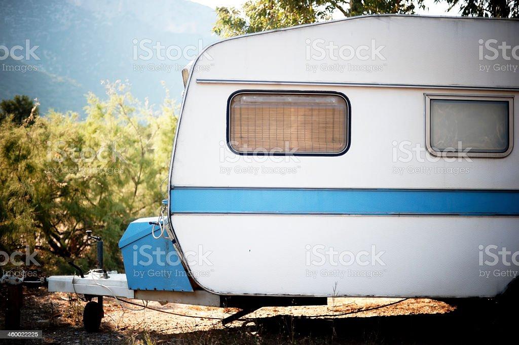 Old towable recreation vehicle stock photo
