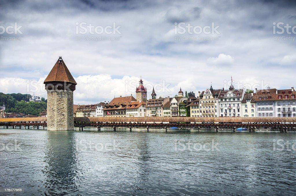 Old Tower and Bridge at Lucern Switzerland stock photo