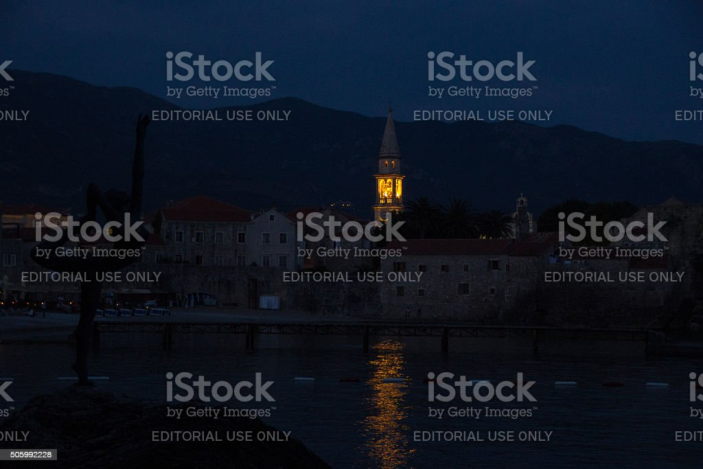 Old town budva and silhouette bronze statue of a ballerina stock photo