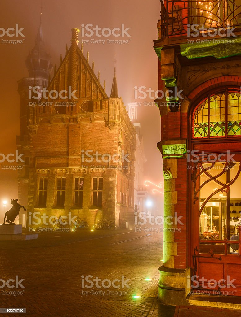 Old Town Hall in Kampen during a foggy night stock photo