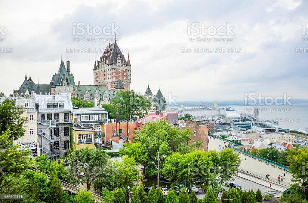 Old town houses on hill with Fairmont Le Château Frontenac stock photo