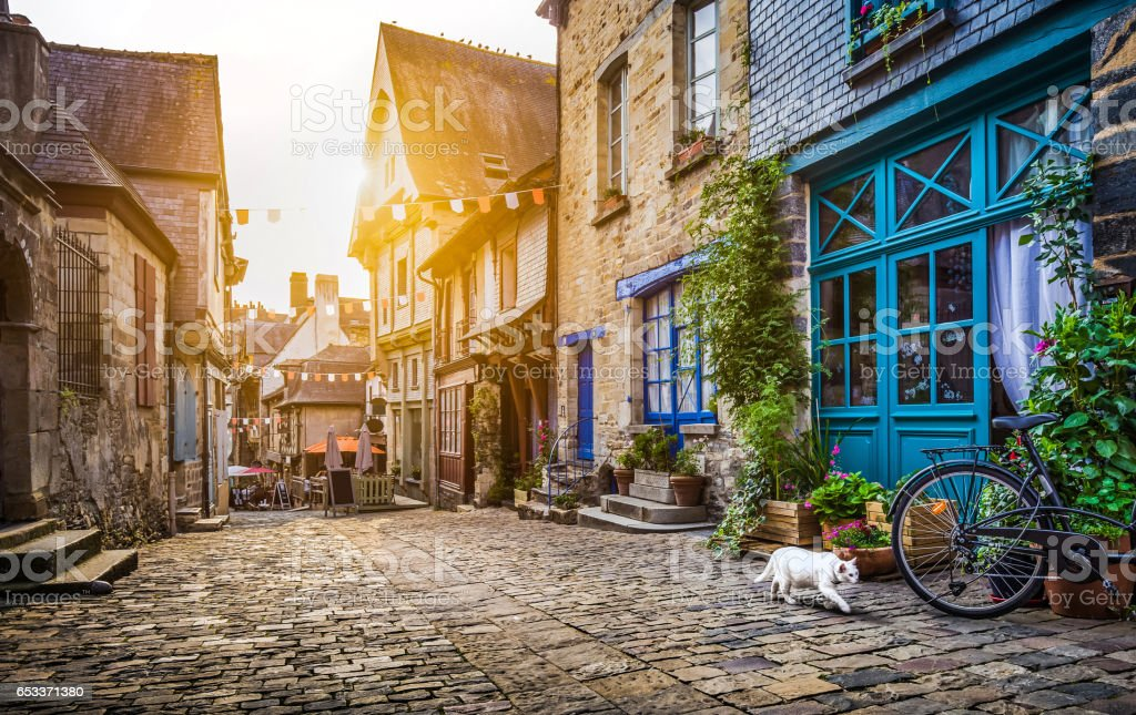 Old town in Europe at sunset with retro vintage Instagram style filter and lens flare effect stock photo