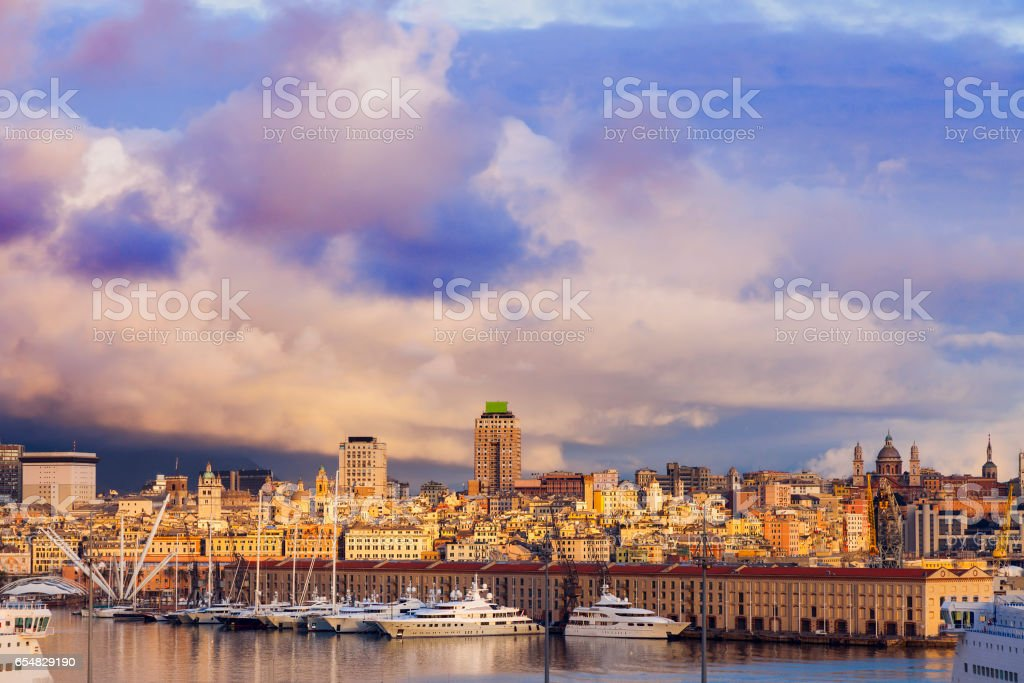 Old town in Genoa across the harbor stock photo